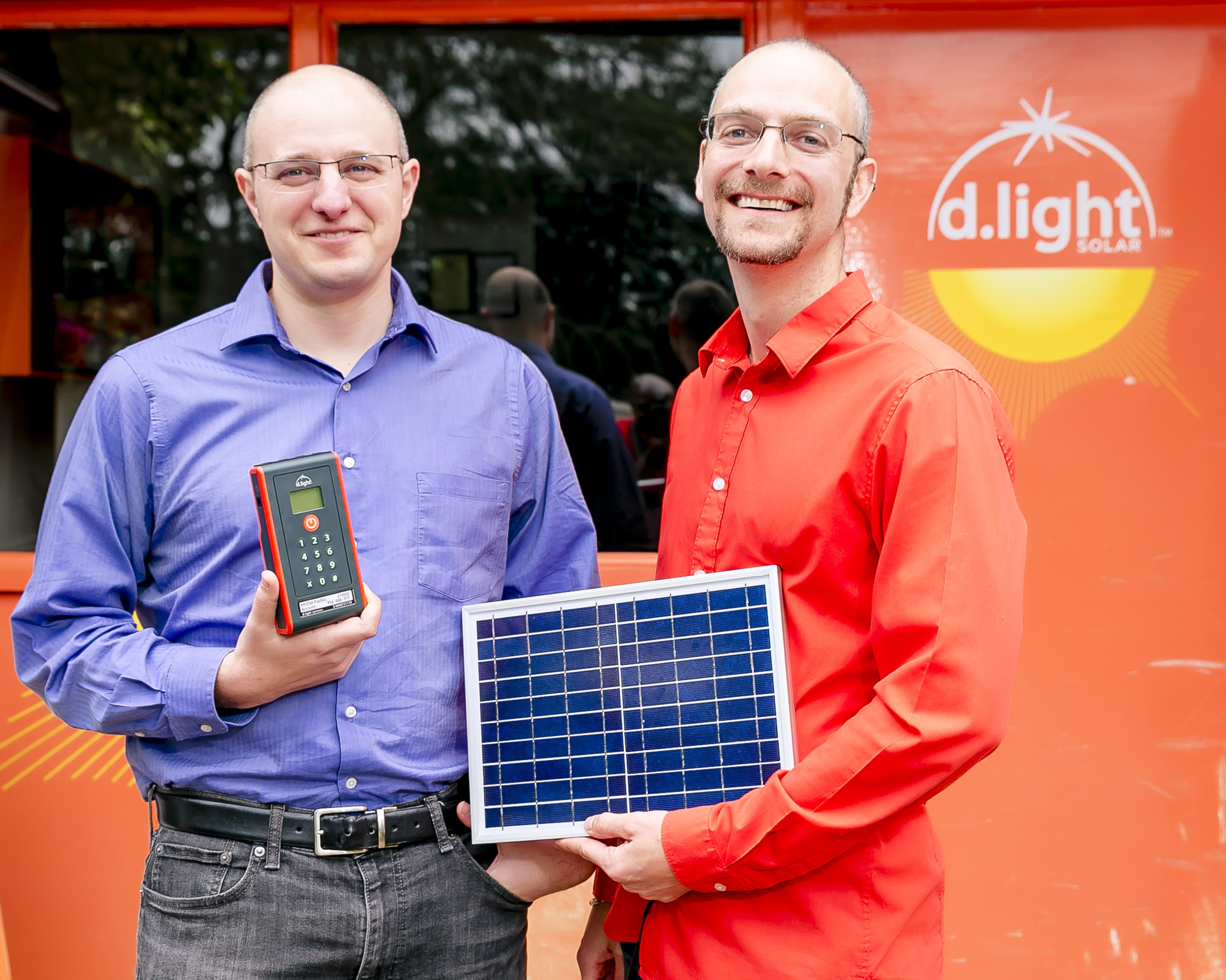 A current shot of co-founders, Ned and Sam, with d.light products.