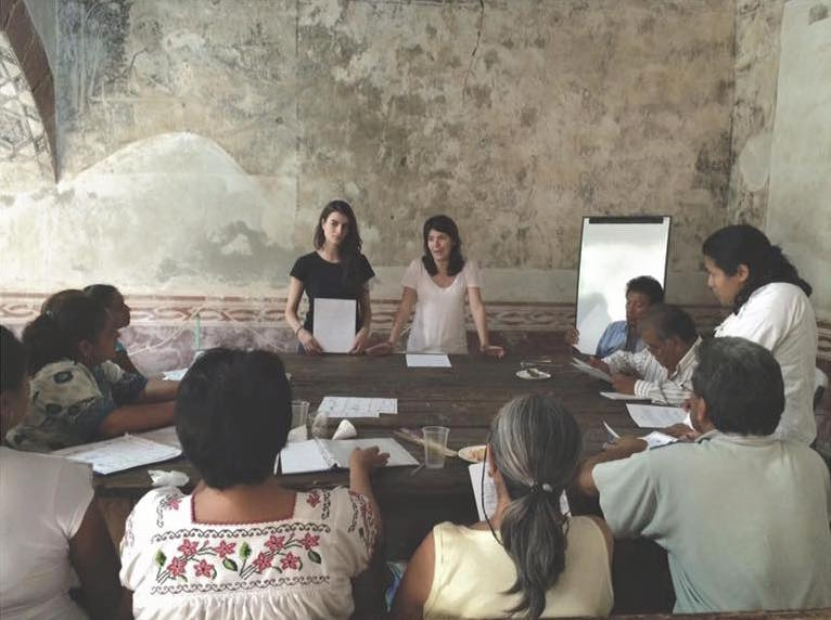 The co-founders of Kukua lead a workshop for women about moringa.
